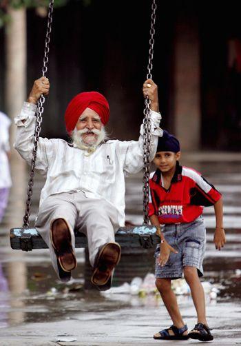 boy pushing dad on a swing