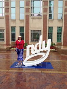 Standing outside in the rain, and walking back to the car. Decided I needed a pic with the ndy sign! lol the person makes the 'I' and if I hadn't been doing the bad thing, the pose would've been much different! ;)