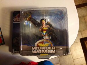 made it home and hubs handed me a bag, this was one of the surprises inside! Sweet Wonder Woman!! and yes, better photo once she is out of the plastic. ;)